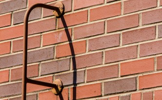 Art Photos - Pipe On Brick